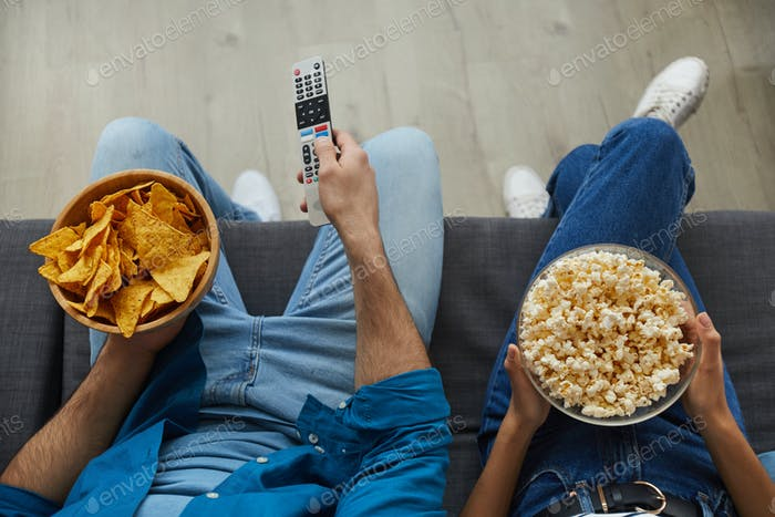 Couple Watching TV with Snacks Top View