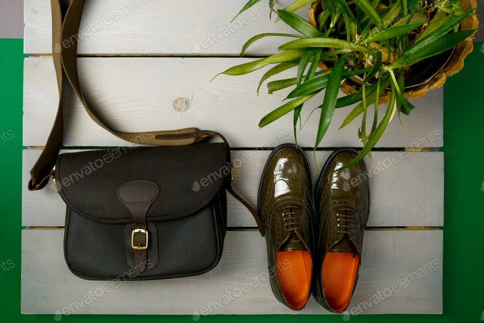 Green lacquered oxford shoes and crossbody bag