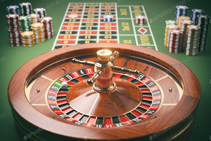 Casino roulette wheel with casino chips on green table. Gambling