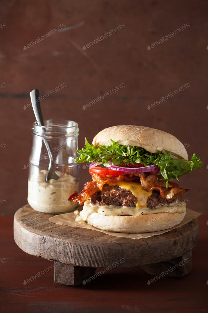 bacon cheese burger with beef patty, tomato and onion