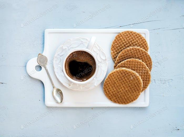 Dutch caramel stroopwafels and cup of black coffee