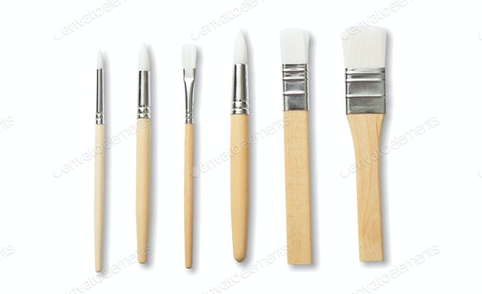 Paint brushes new clean with wooden handle isolated against white background.