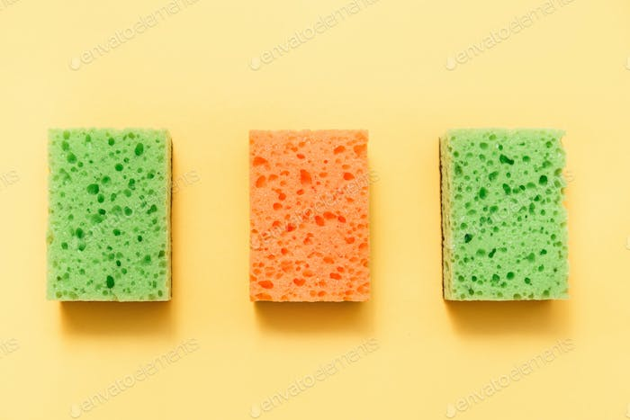 Colorful sponges with isolated on yellow