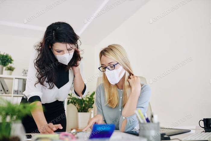 orking in office in surgical masks