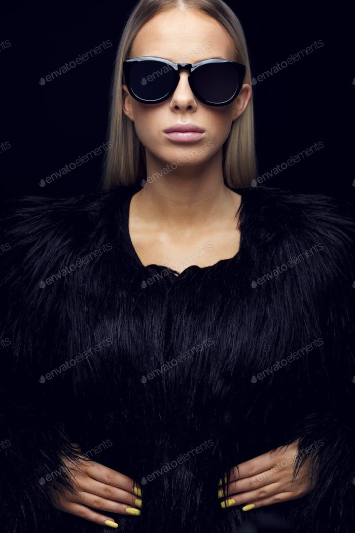 Confident Young Woman In Fur Clothing