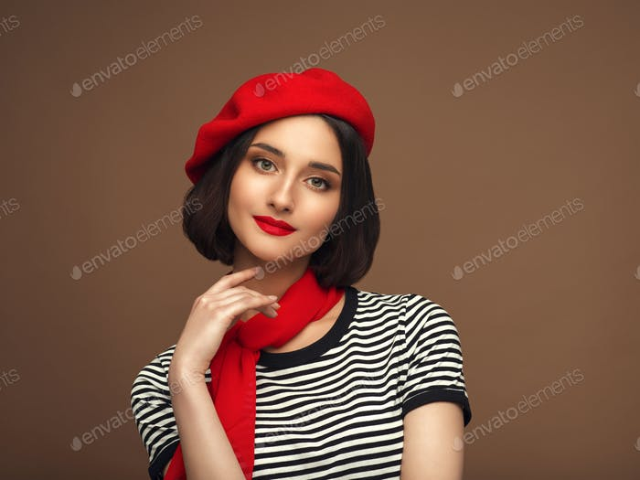 Woman in red beret and strippes T-shirt french style brunette