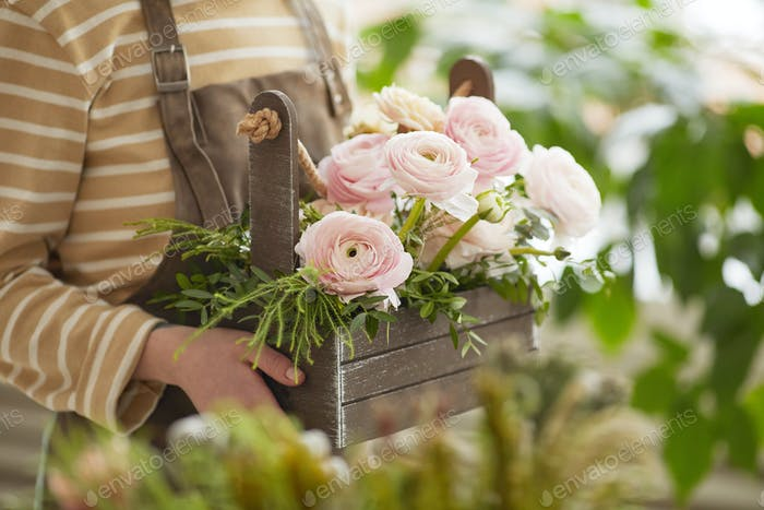 Female Florist Holding Flowers Close Up