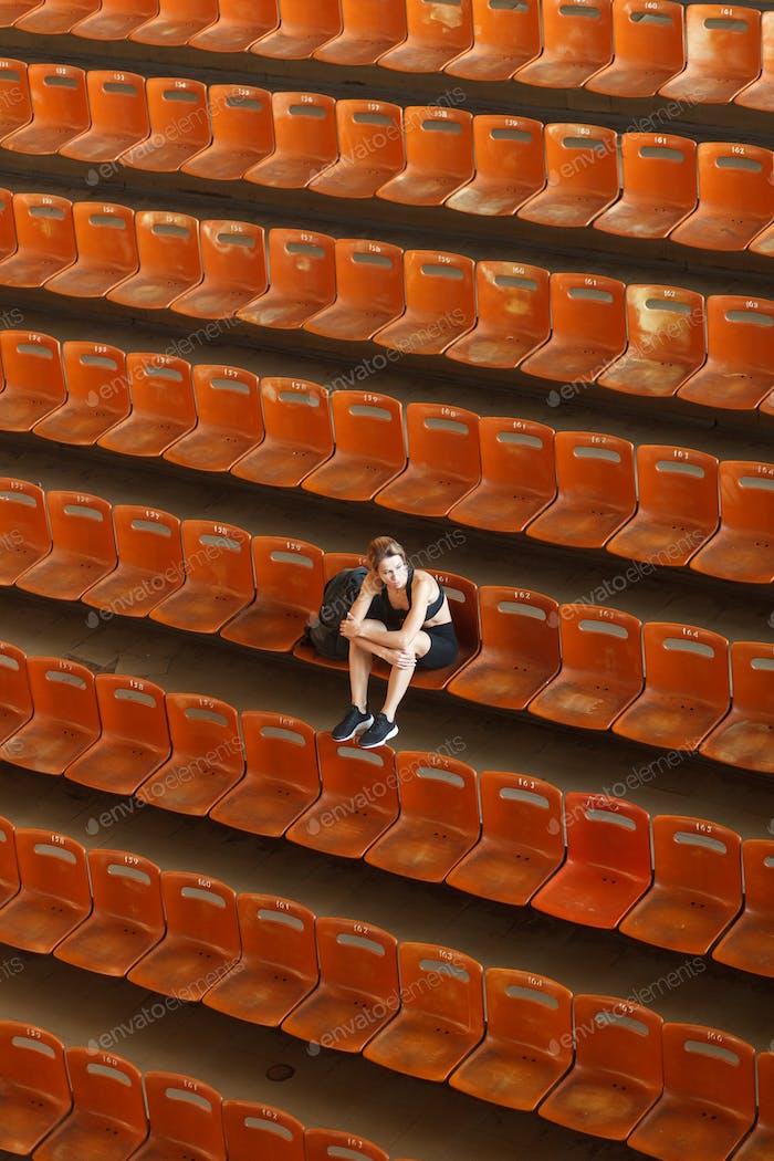 young blonde beautiful sportswoman training on athletic stadium