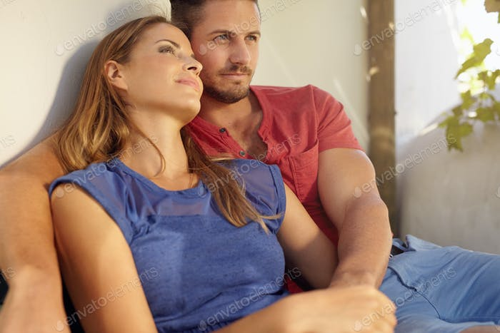 Loving young couple relaxing on patio