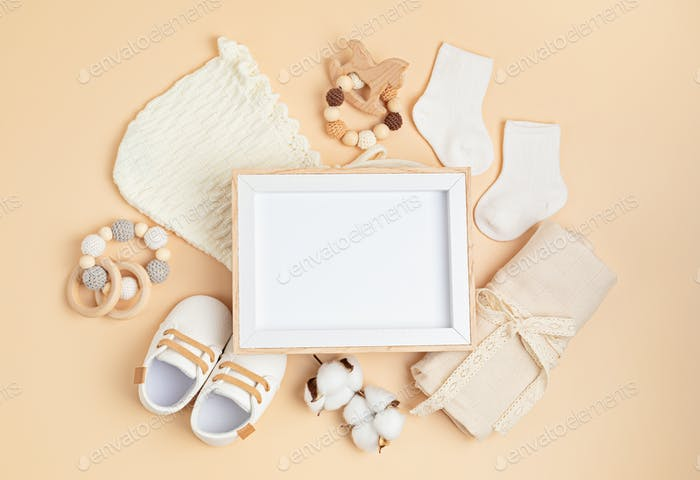 Mockup of empty frame with eco friendly baby accessories