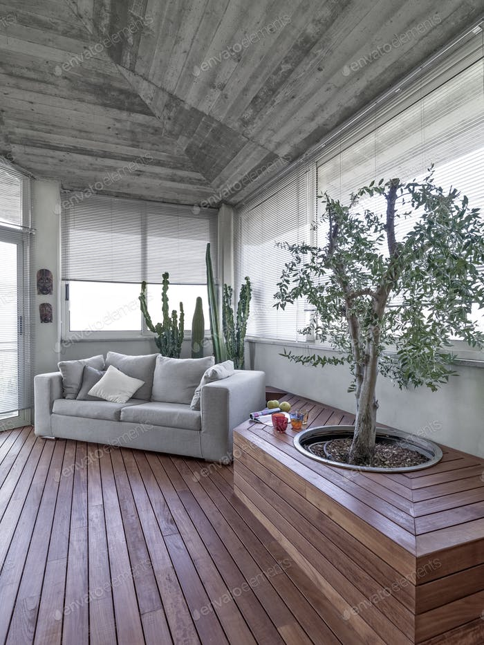 a Modern Terrace with Wood Floor and Concrete Ceiling