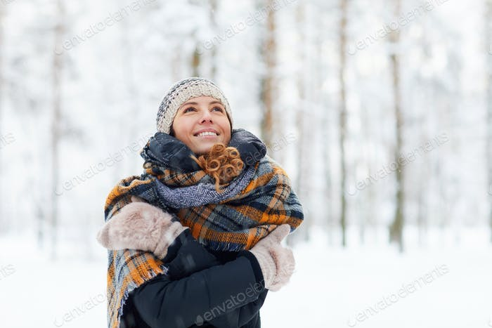 Happy Young Woman Enjoying Winter