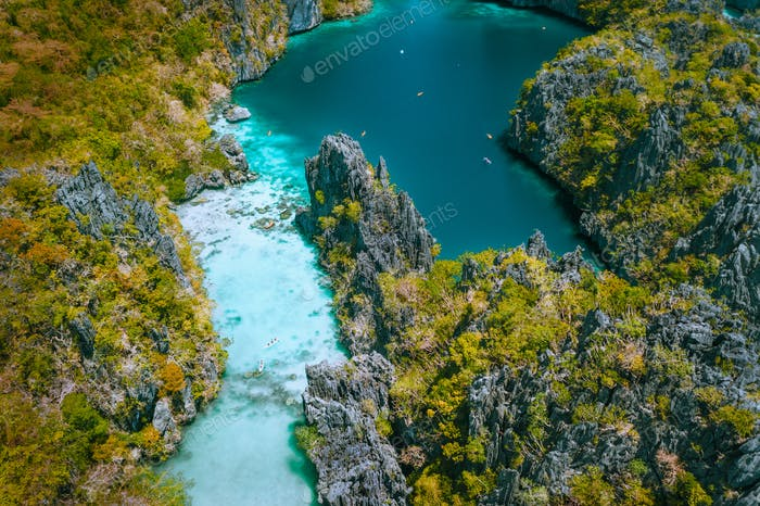 Aerial drone view of a beautiful tropical Big Lagoon at Miniloc Island, El Nido, Philippines