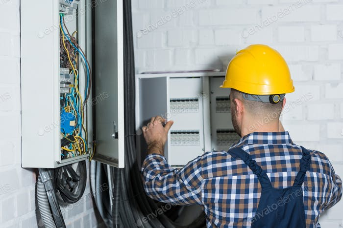 Male electrician repairing circuit line