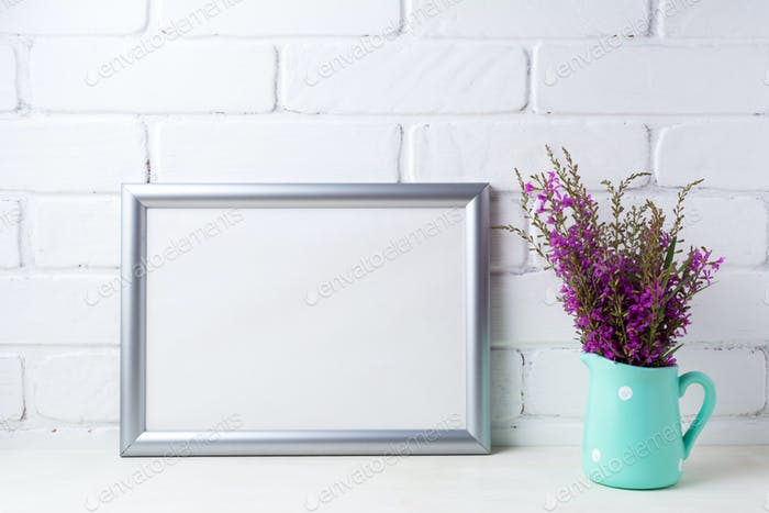 Silver landscape frame mockup with maroon purple flowers in mint
