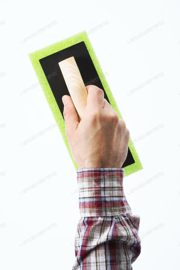 Decorator holding a painting pad