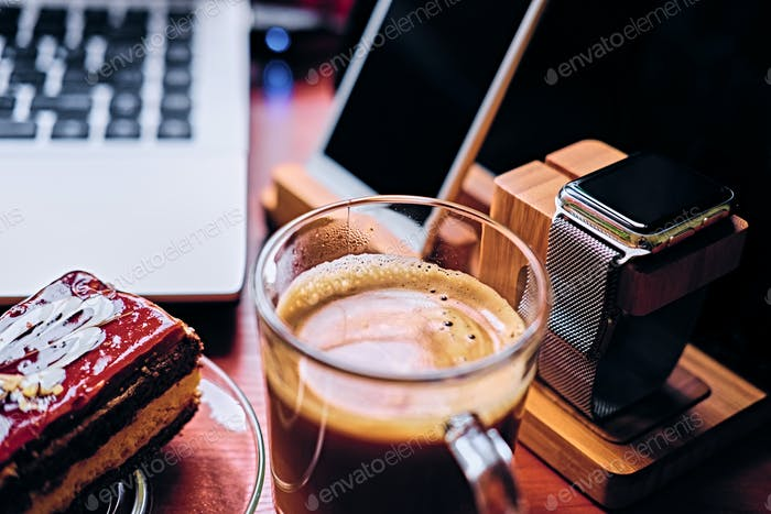 Sweet cake, cup of coffee on a table