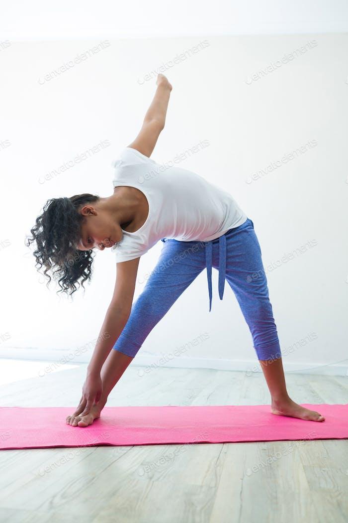 Girl exercising in room