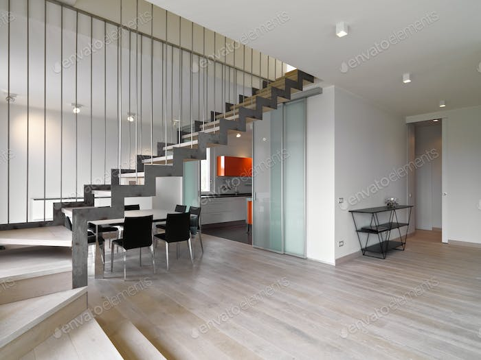 Interiors of a Modern Living Room with a Staircase