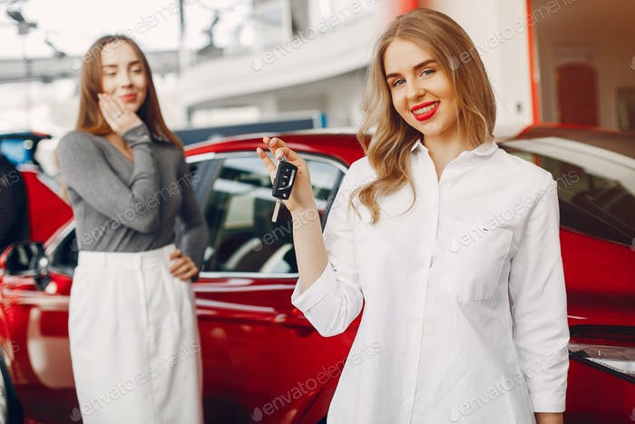 Two stylish women in a car salon
