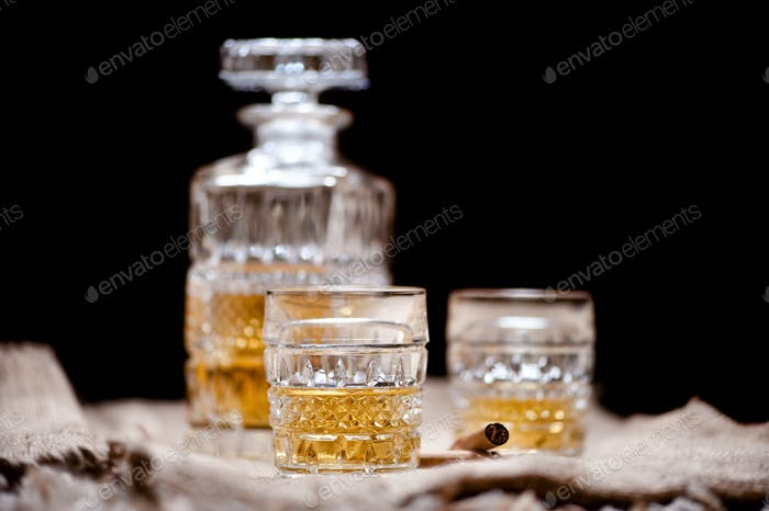 whiskey crystal bottle and glasses with alcoholic booze