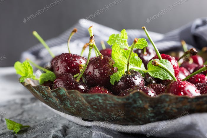 Fresh cherries with water drops.
