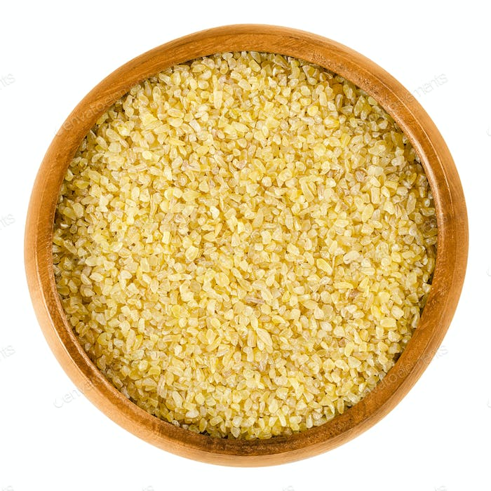 Uncooked bulgur or burghul in wooden bowl