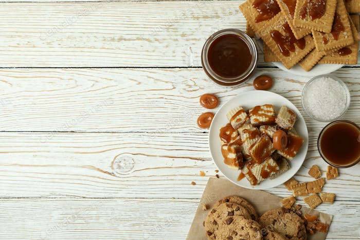 Tasty snack concept with cookies with caramel on white wooden table