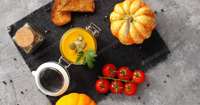 Pumpkin soup with vegetables on napkin