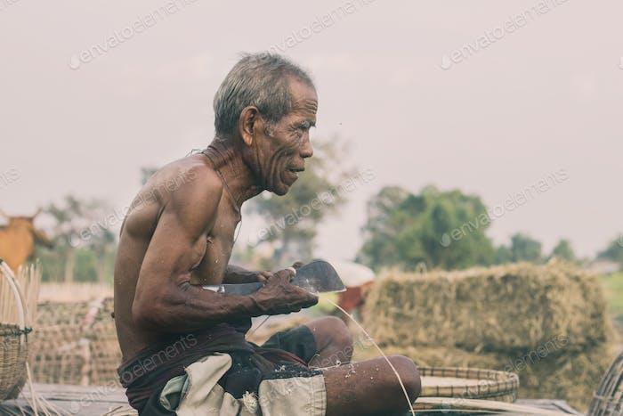 Old man on bamboo mat