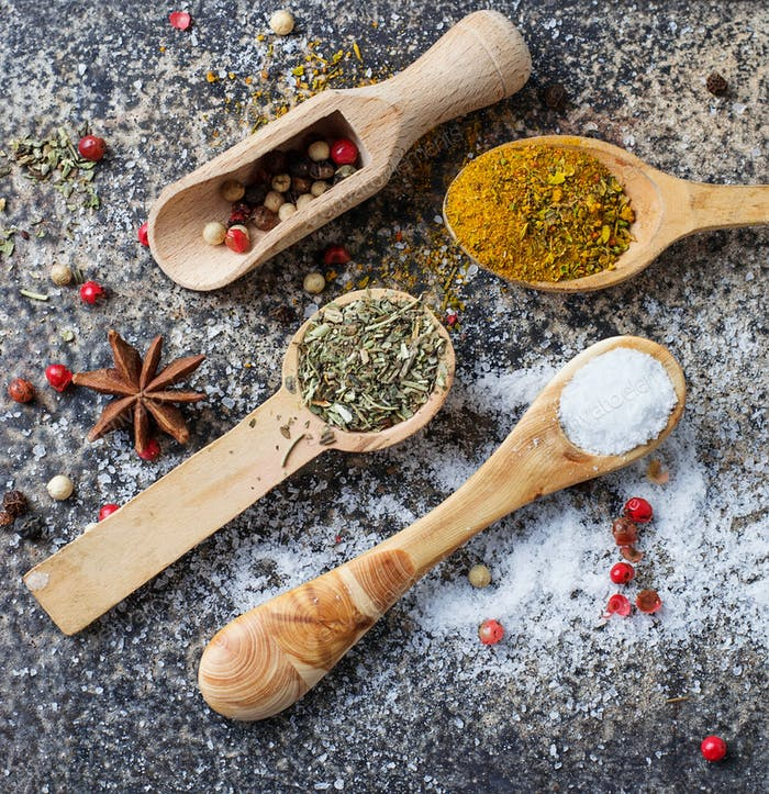 Different kinds of spices in wooden spoon