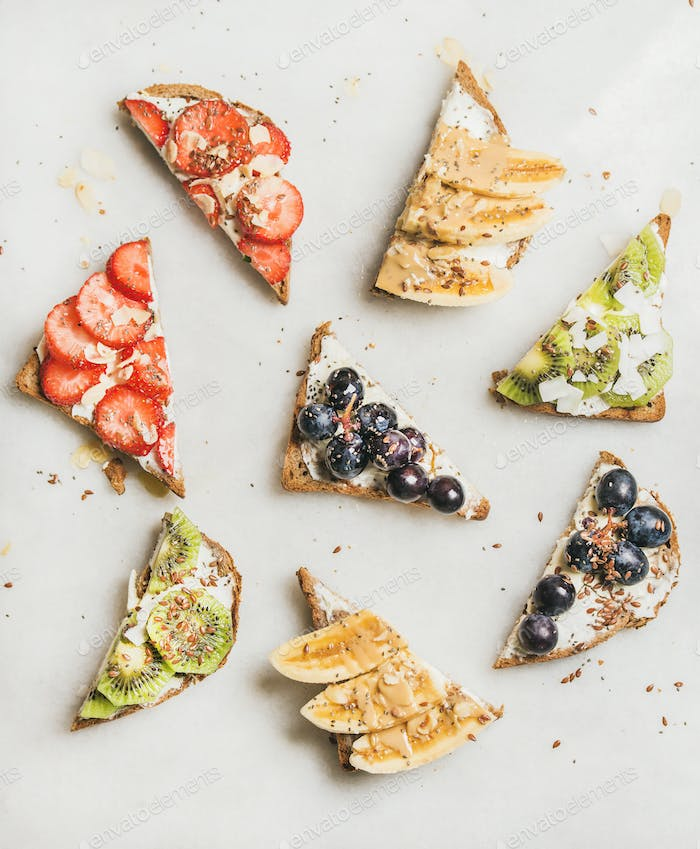 Healthy breakfast toasts with fruit, nuts, seed and cream cheese