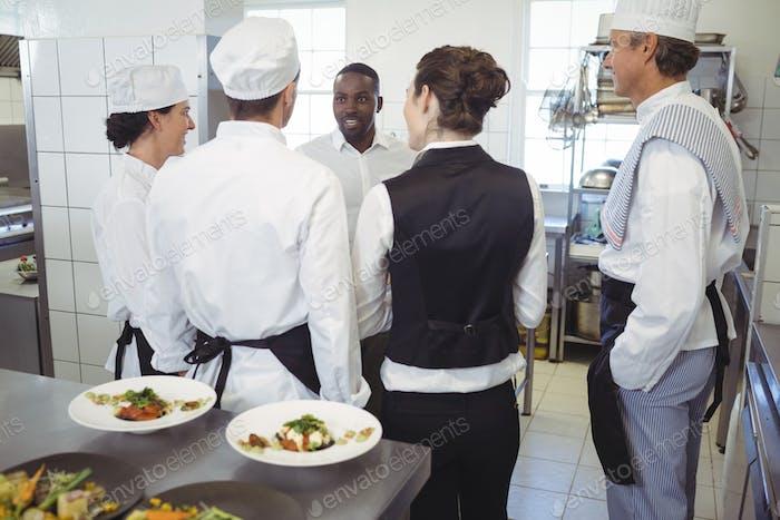 Restaurant manager briefing to his kitchen staff