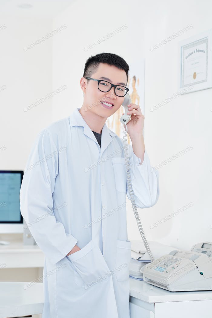 Physician answering phone call