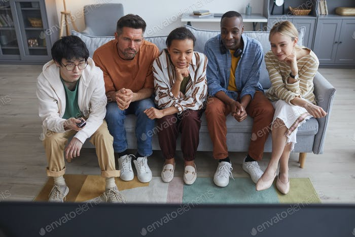 Diverse Young People Watching TV on Sofa
