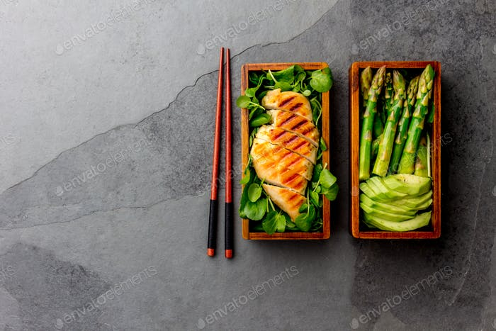 Heathy Lunch in Wooden Japanese Bento Box. Grilled Chicken, Asparagus, Avocado