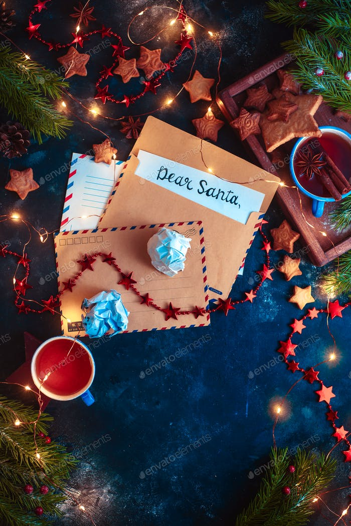Letters to Santa concept, Christmas flat lay with fairy lights, star-shaped cookies, and tea