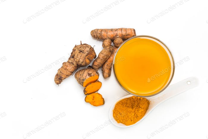 Healthy turmeric roots drinks in a transparent glass.