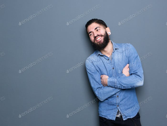 Stylish man smiling with arms crossed