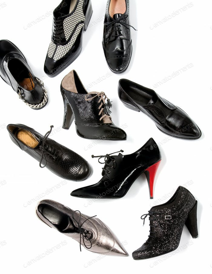 Black masculine female shoes still life fashion composition