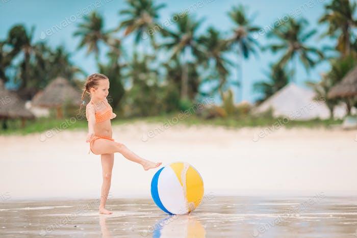 Young beautiful girl having fun on tropical seashore