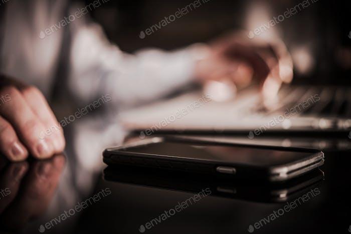 Cellphone on the Glassy Desk
