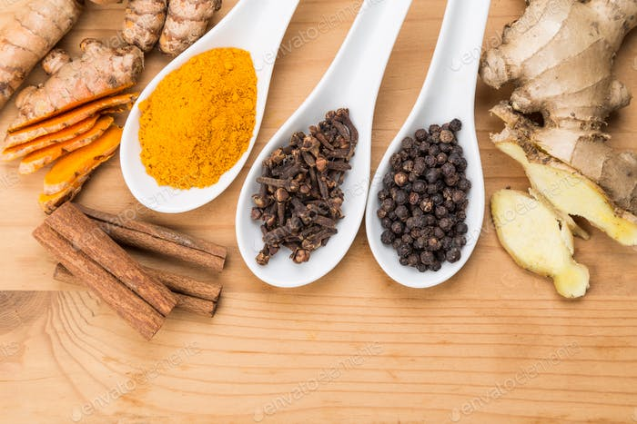 Ingredients for turmeric tea consisting ginger, cinnamon, cloves