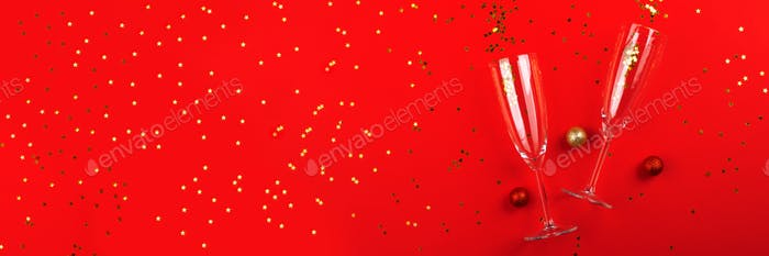Champagne glass with confetti on red. Long banner