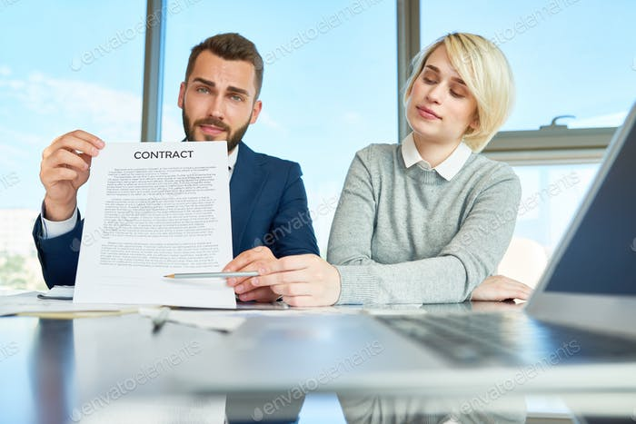 Business People Presenting Contract