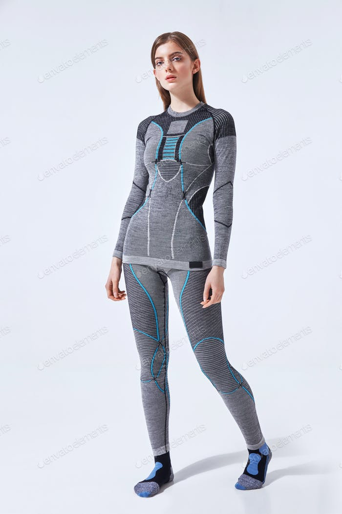 Young woman in hot sports thermal underwear on isolated studio background
