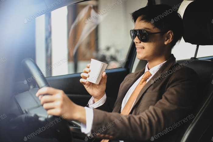 Businessman driving and have a coffee
