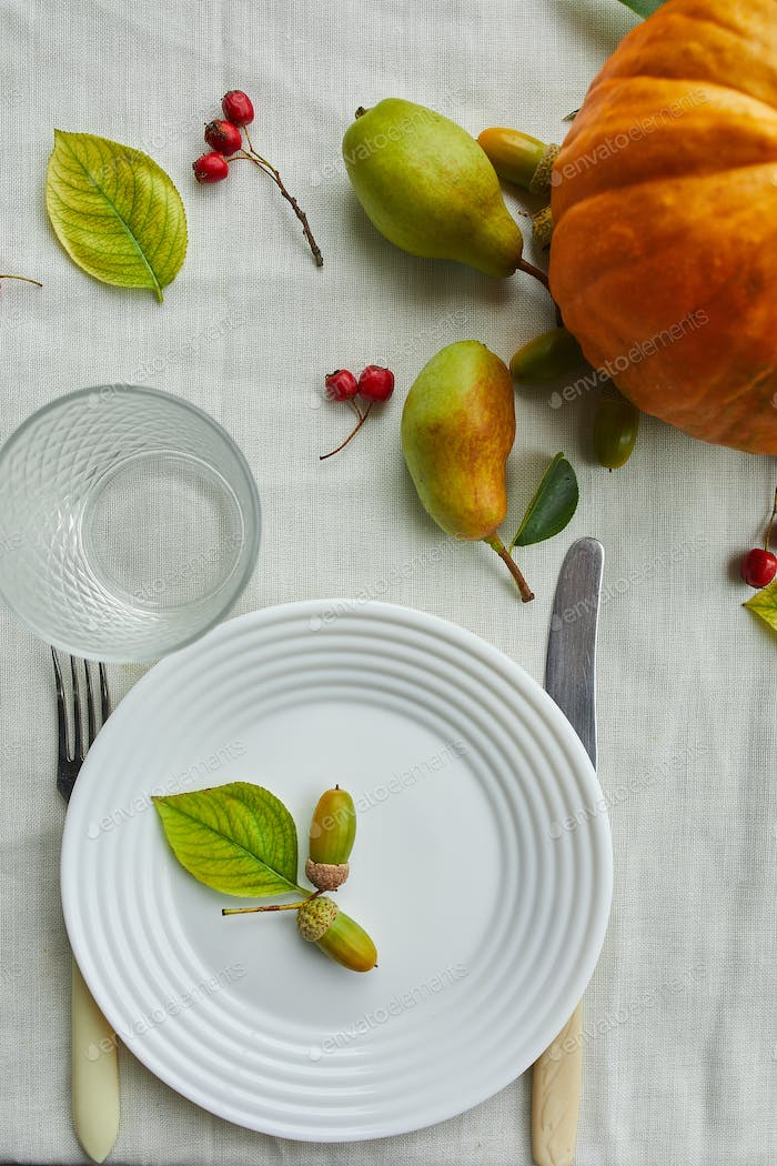 Thanksgiving Day or Halloween dinner table place setting