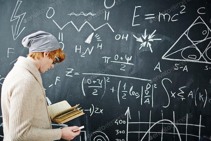 Student by blackboard