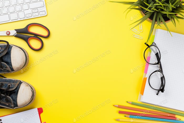 Yellow backdrop with supplies and computer